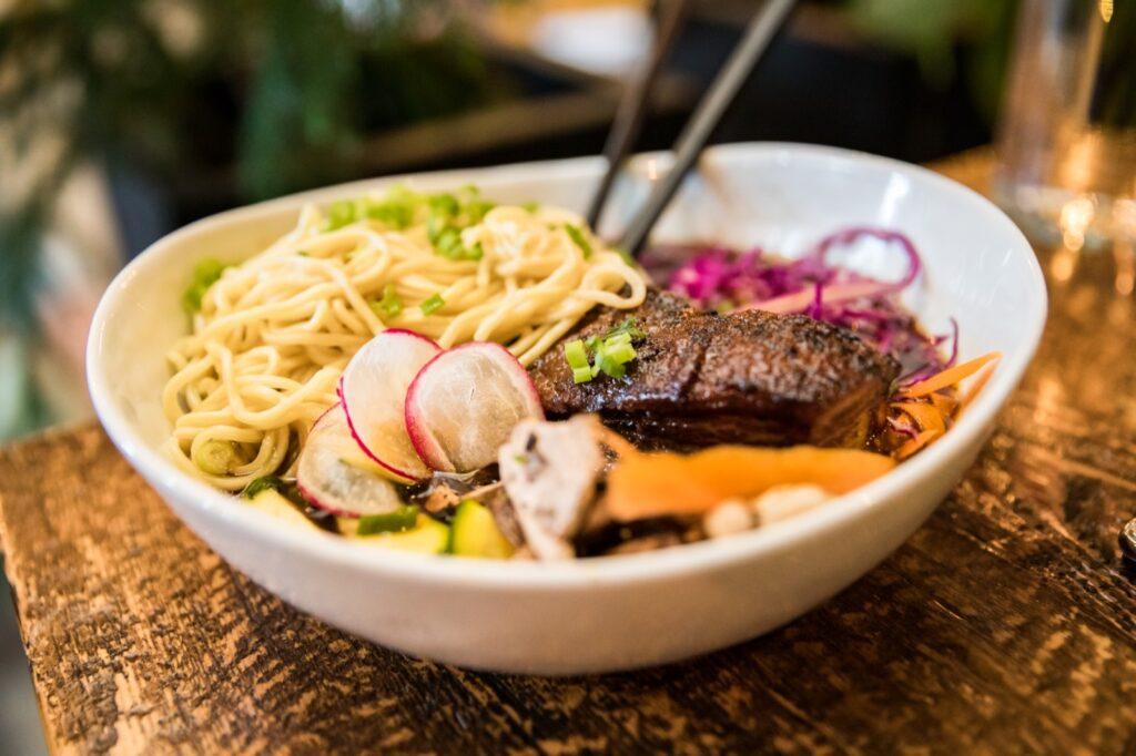 Trying new restaurants when traveling ramen bowl